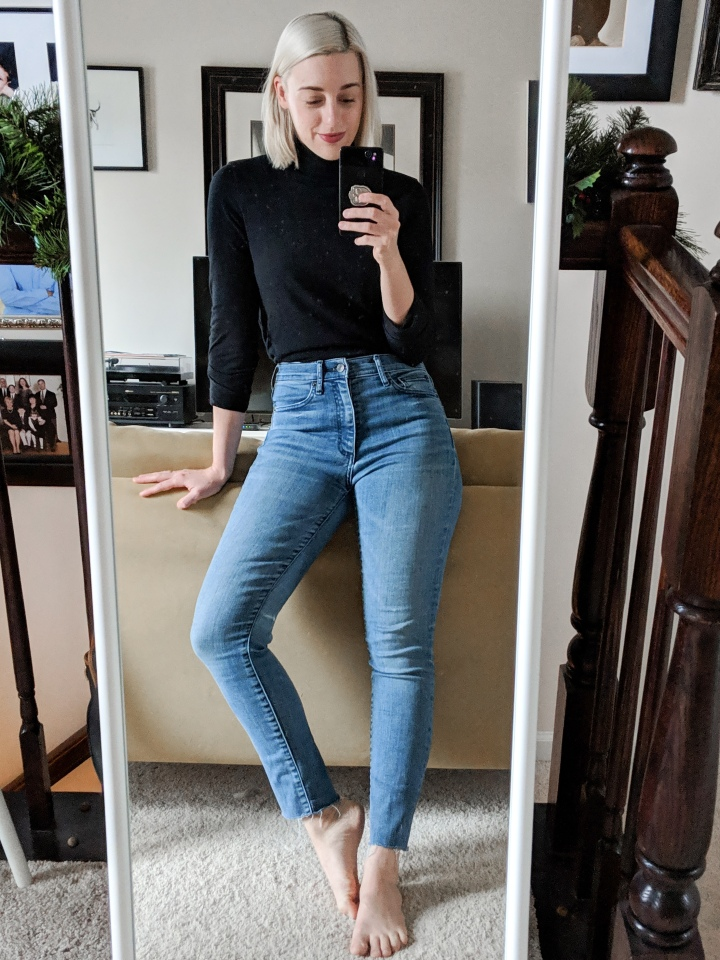 author in an everlane turtleneck and jeans