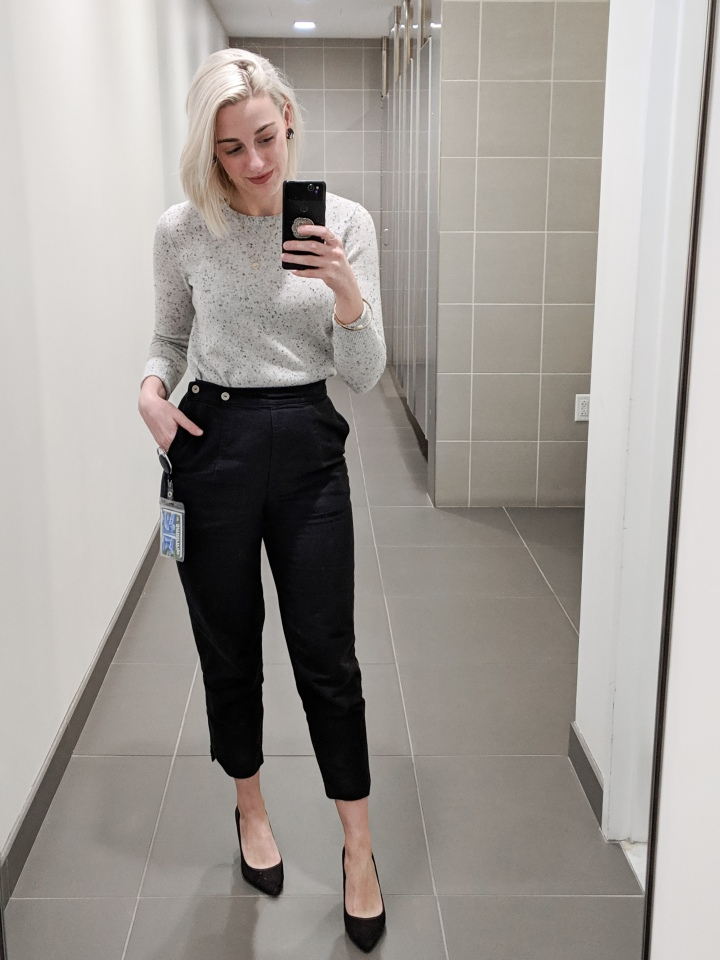 author in an everlane cashmere crew sweater and black pants
