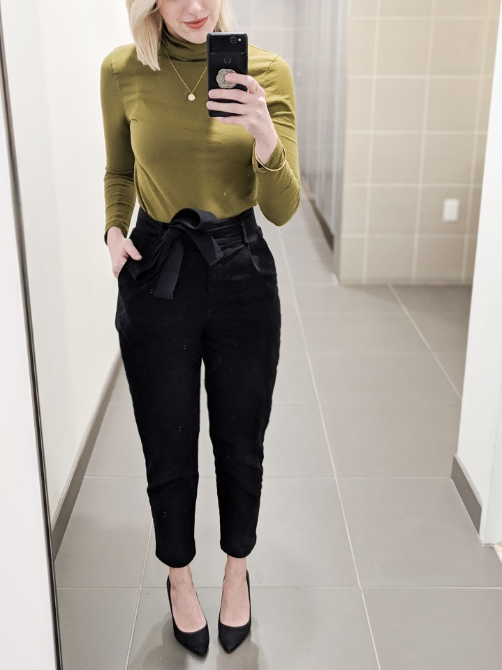 author in a green turtleneck