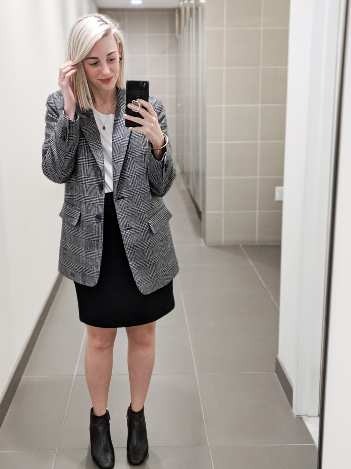author with blonde hair and a blazer