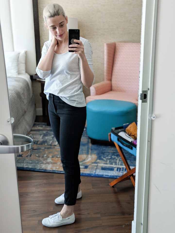 author in stripe shirt and jeans