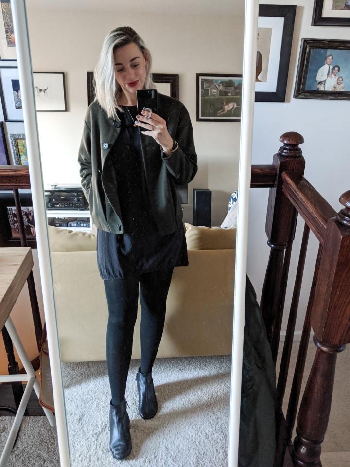 green coat black dress